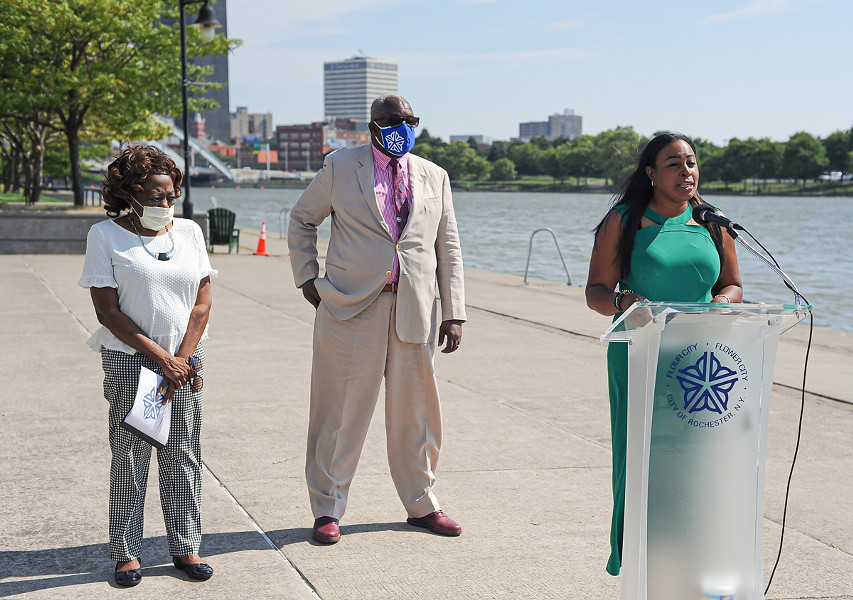 Mayor Lovely Warren, right, stands with Commissioner of Environmental Services Norman Jones and City Council President Loretta Scott to announce the start of a project to rebuild a section of the west wall of the Genesee River. - PHOTO BY JEREMY MOULE