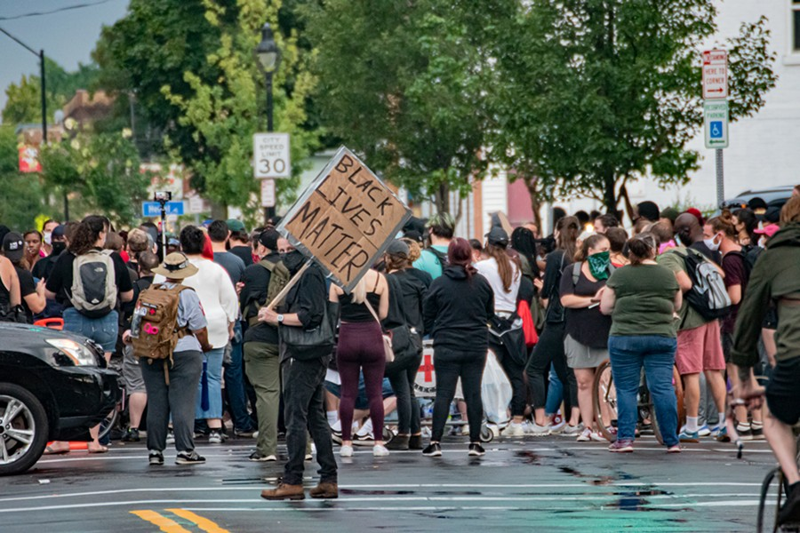 Protesters gathered at the intersection of Jefferson Avenue and Dr. Samuel McCree Way. - PHOTO BY JACOB WALSH