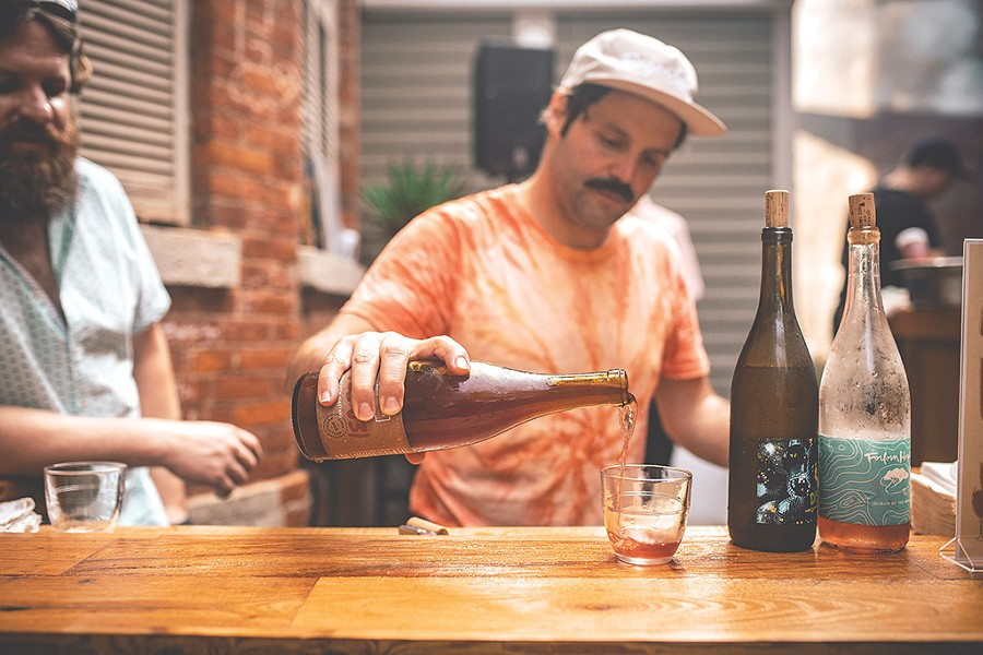 Brandon Opalich pours curated wine selections at an Aldaskeller Wine Co. pop-up tasting event in 2019. - PHOTO BY JASON CAMPBELL