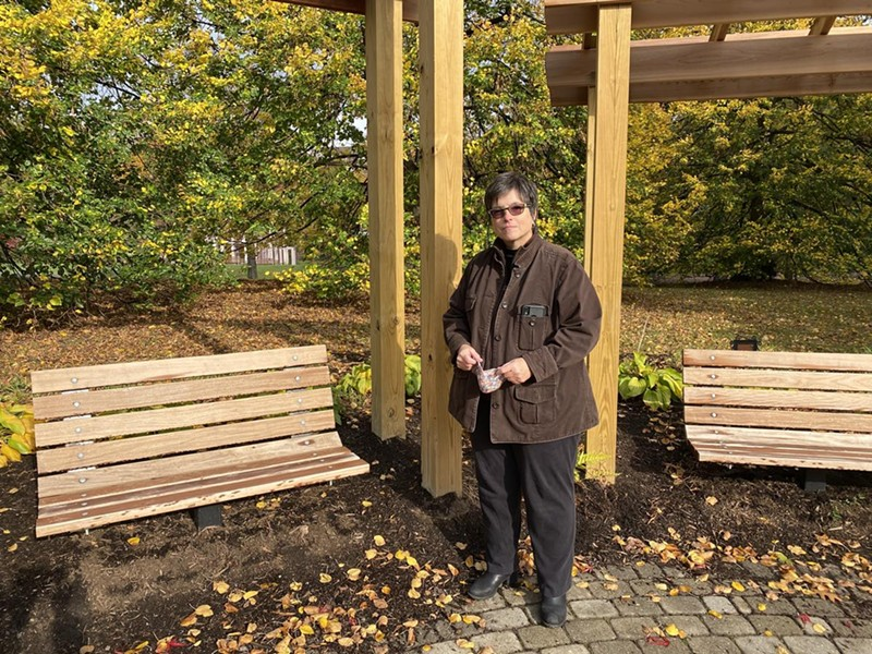 Gillian Conde stands in the Remember Garden she helped create. - PHOOT BY VERONICA VOLK