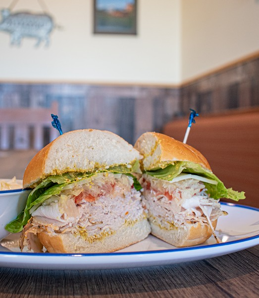 Roasted turkey on a hard roll with sauerkraut. - PHOTO BY JACOB WALSH