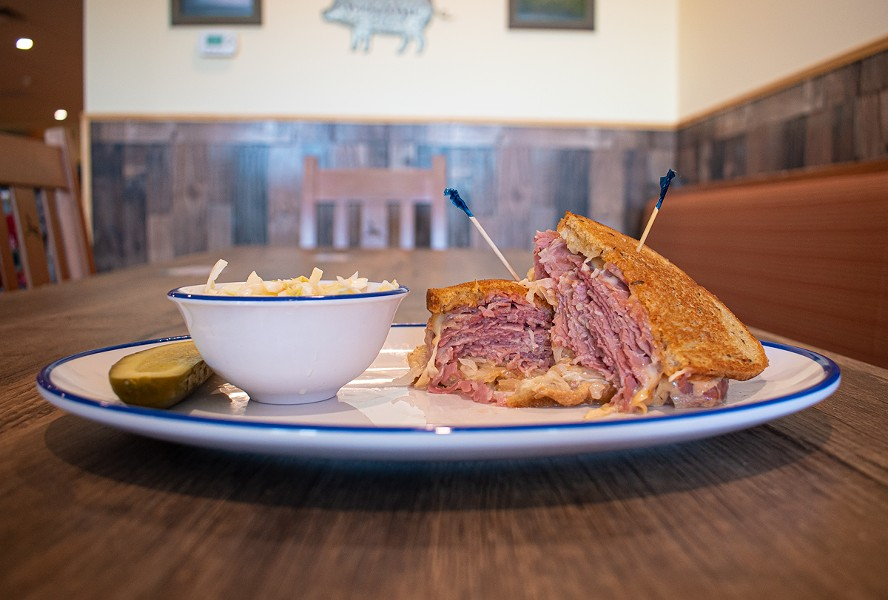 A reuben sandwich with a side of coleslaw. - PHOTO BY JACOB WALSH