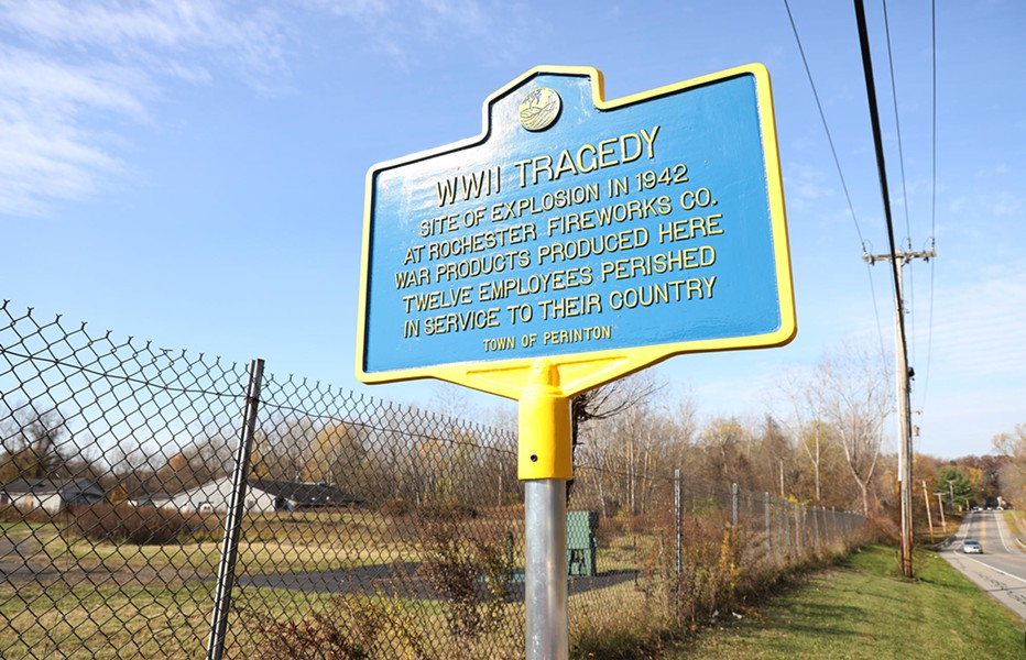 An historic marker at the site of the former Rochester Fireworks Company on Whitney Road in Perinton. On November 6, 1942, an explosion at the plant sparked a fire that killed twelve people. - PHOTO BY MAX SCHULTE
