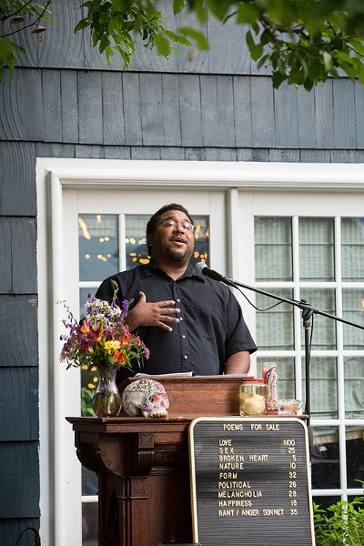 Ohio poet Scott Woods was a featured reader at the July 11event. - PHOTO BY JOHN SCHLIA