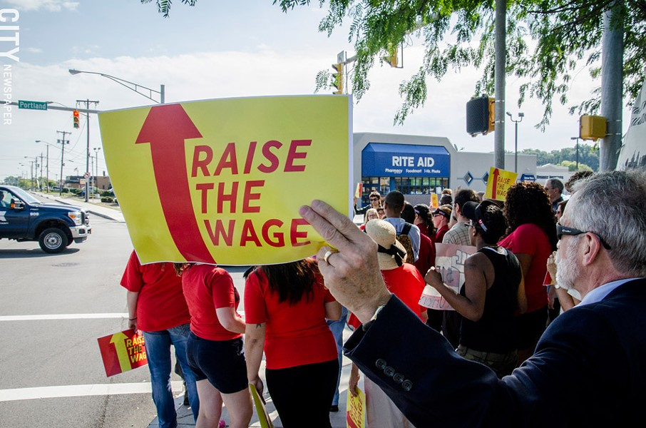 Metro Justice members and fast food workers held Rochester's first Fight for $15 rally in September 2014. - FILE PHOTO