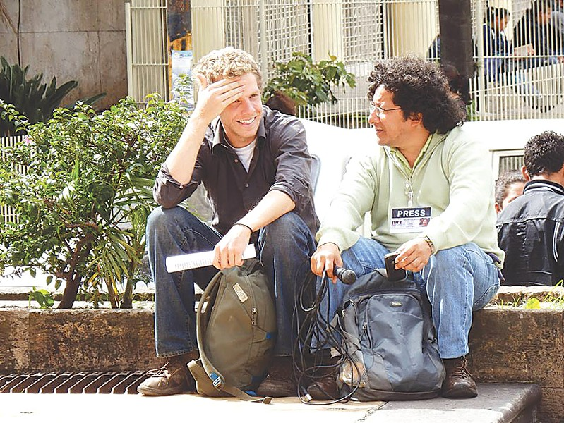 Canadian documentary filmmaker Jesse Freeston (left) discusses projects with Honduran radio host and producer Félix Molina. - PHOTO PROVIDED