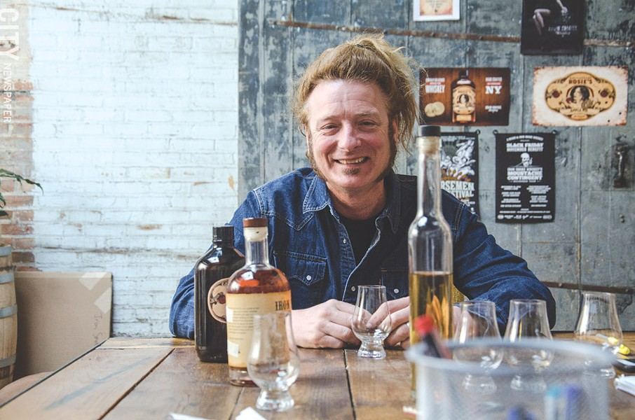 Rocker Tommy Brunett is co-owner of Fairport's Iron Smoke Whiskey. - PHOTO BY MARK CHAMBERLIN