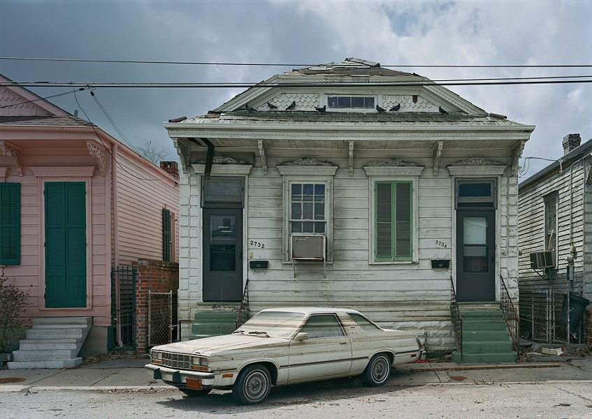"""After the floods receeded, watermarks stain a car and houses in post-Katrina New Orleans. This photograph is part of """"Robert Polidori: Chronophagia,"""" which is on view at the Memorial Art Gallery through July 24. - PHOTO PROVIDED"""