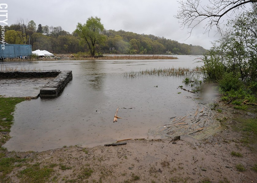 Water creeps up a boat launch at LaSalle's Landing in Penfield. - PHOTO BY JEREMY MOULE