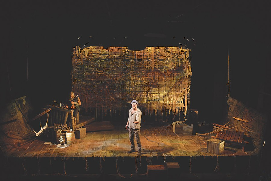 """An Iliad"" on stage at Geva in 2016 featured scenic design by John Haldoupis and costume design by Georgiana Londré Buchanan. - PHOTO BY GOAT FACTORY MEDIA"