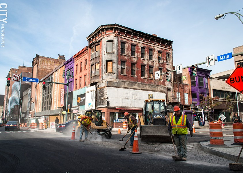 The large billboard on the top of a building at Main and Clinton has been removed, exposing its original architectural features. - PHOTO BY RYAN WILLIAMSON
