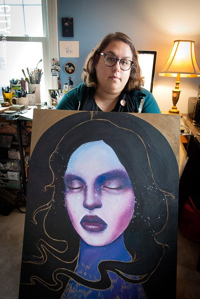 Shawnee Hill in her home studio with one of her paintings. - PHOTO BY RYAN WILLIAMSON