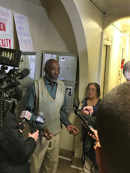 John Lindsey, a tenant of 447 Thurston Road whose bathroom ceiling collapsed several weeks ago and hasn't been repaired, speaks to reporters at a press conference in his building. - PHOTO BY JAKE CLAPP