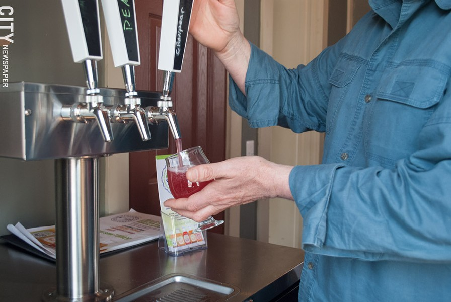 Tim Garman of Timbucha pours a cranberry-pear kombucha at Fairport Brewing Company. The biz offers six flavors on tap. - PHOTO BY JACOB WALSH