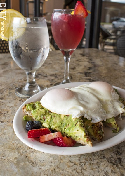 Blades' Avocado Toast and Pink Lady mimosa. - PHOTO BY RENÉE HEININGER