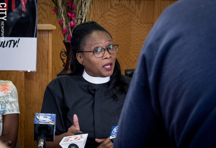At a press conference today, Pastor Wanda Wilson and other members of the Police Accountability Board Alliance said draft police-oversight legislation doesn't go far enough. - PHOTO BY JACOB WALSH