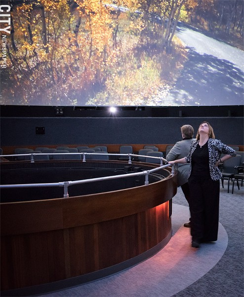 RSMC president and CEO Hillary Olson gazes up at Star Theater's dome. - PHOTO BY JACOB WALSH