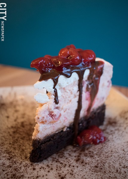 Caramel Bakery and Bar's Forbidden Forest layers chocolate cake with cherry cheesecake. - PHOTO BY RENÉE HEININGER