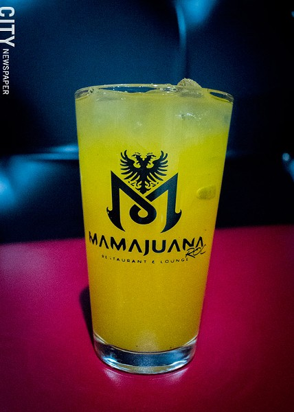Fresh mango juice from MamaJuana's juice bar. - PHOTO BY RYAN WILLIAMSON