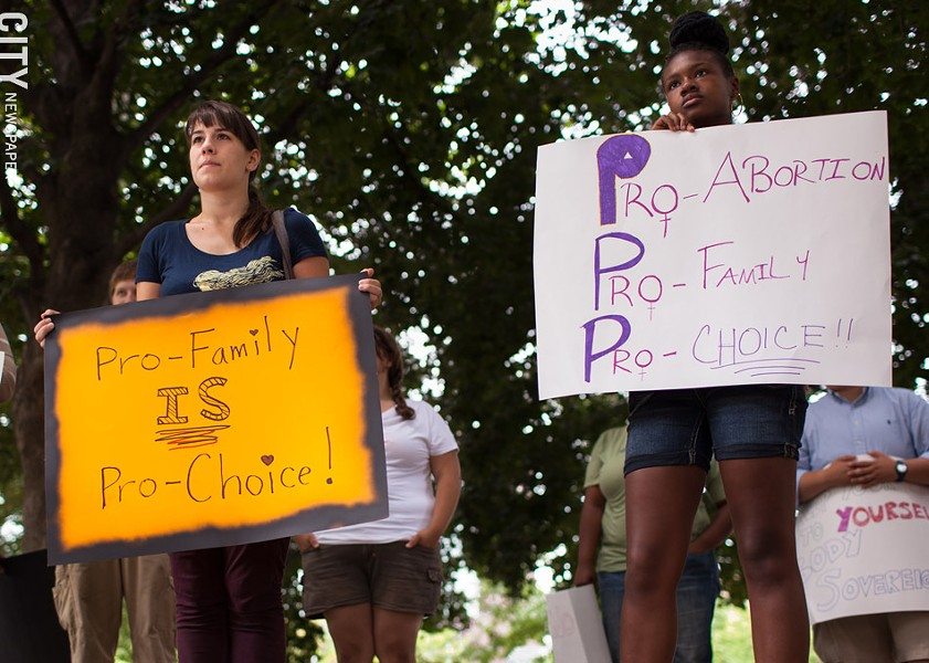 Abortion rights supporters during a 2013 demonstration protesting a an anti-abortion group's annual meeting, which was held in Rochester that year. - FILE PHOTO