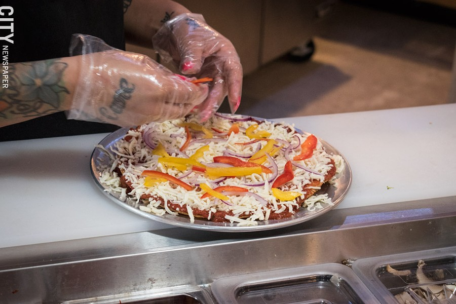 Following the fast-casual model of eateries like Chipotle, the pies at Create A Pizza are created to the customer's specifications. - PHOTO BY JACOB WALSH