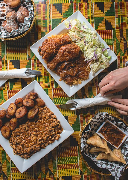 Clockwise, from bottom left: Aboboi and rice with fried plantains, jollof rice with chicken, bofrot (puff puff), and samosas at Akwaaba Restaurant. - PHOTO BY RYAN WILLIAMSON