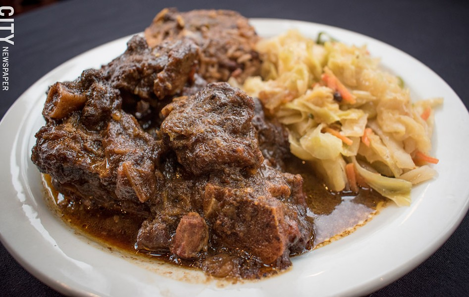 Oxtail, a Jamaican staple, is on the menu at Caribbean Heritage Restaurant. - PHOTO BY JACOB WALSH