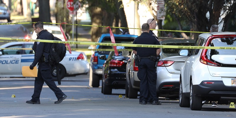 Rochester police respond Saturday to Pennsylvania Avenue, the site of a mass shooting that left two dead and 14 wounded. Evidence markers line the sidewalks and street in front of the scene.