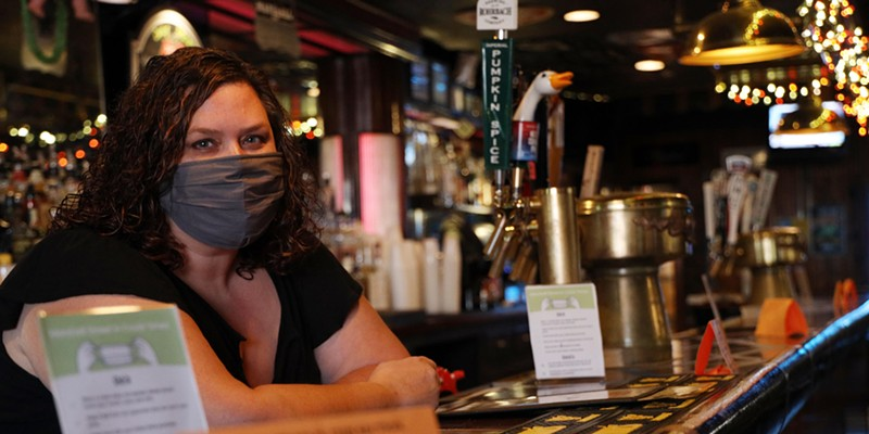 Kelly Bush, owner of the Marshall Street Bar and Grill, behind the bar. Bush is also president of the Rochester chapter of the New York State Restaurant Association.