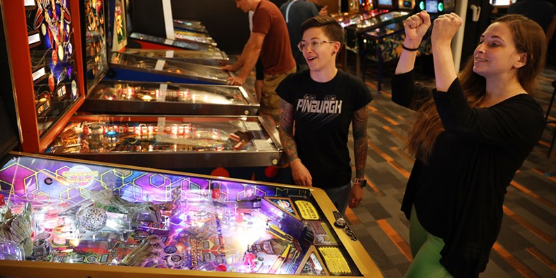 Jeanette Fredrick, left, and Stacy Fredrick are fast becoming regulars at Rochester Pinball Collective.