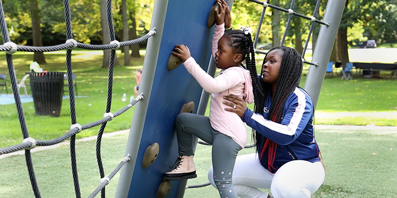 Tashe Brown-Sanders enjoys a playdate with her daughter Wynter at Cobbs Hill in Rochester.