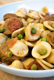 """Conchiglie alla Burino, made with vegan butter, Grass Fed's Italian """"sausage,"""" tomatoes, white wine, garlic, onions, and peas."""