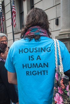 Housing activist Ryan Acuff outside of the Monroe County Office Building prior to a state Assembly hearing on rental housing and tenant protections.