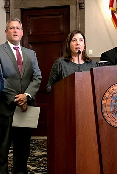 """Republican Monroe County Legislator Karla Boyce, flanked by Democrats, explains her decision to vote to repeal the """"police annoyance"""" law she sponsored months ago. Pictured with her are Democratic Minority Leader Vincent Felder, County Executive Adam Bello, and Legislator Ernest Flagler-Mitchell."""