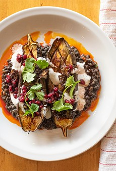 Roasted eggplant with lentils, crispy Brussels sprouts, chevre, and ras el hanout.