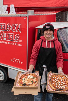 Luis Perez with a couple of Neapolitan pizza pies outside his Peels on Wheels Piaggio Ape