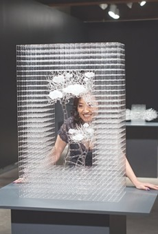 Eunsuh Choi with one of her intricate glass sculptures.
