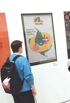 Students check out the Milton Glaser poster show currently on view at RIT's University Gallery.