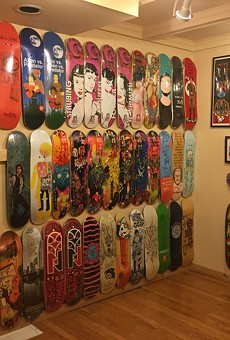 """""""Hoarders of Cool,"""" featuring boards, T-shirts, and other items from the collections of members of the Rochester skateboard community, is on display at AMOR."""