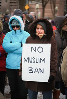 Photo Gallery: Rally Draws Opposition To Trump's Ban