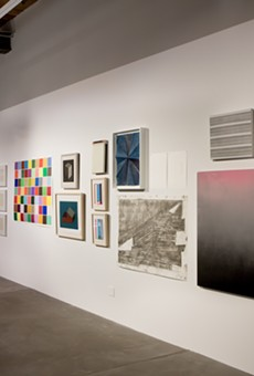 """Installation view of """"Minimal Mostly"""" at R1 Studios, which includes work by Sol Lewitt, Spencer Fish, Mika Tajima, Frank Stella, Amanda Means, and others."""