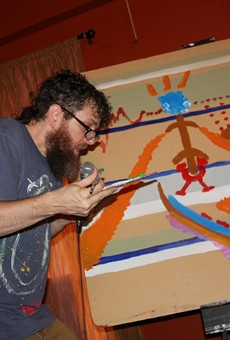 Seth Faergolzia paints while looping music during his show at Abilene.