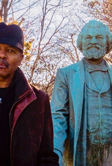 """""""Re-Energizing the Legacy of Frederick Douglass"""" project director Carvin Eison with the statue of Frederick Douglass in Highland Park. The statue will be moved to South and Robinson this spring, and is at the center of several upcoming art-related events."""