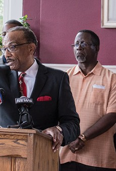 The Rev. Lewis Stewart, center, called for the release of video footage from a police body camera, following the alleged assault of a Rochester man.