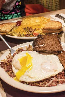 The homemade corned beef hash with over-easy eggs and pumpernickel toast (front) and Artist's omelet (back) at Jim's at The Mall.