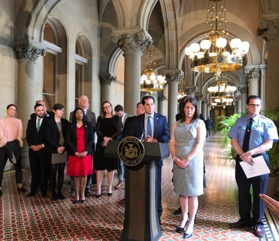 At an early June press conference on climate legislation: Senate sponsor Todd Kaminsky at the podium; to the right, Julie Tighe with the New York League of Conservation Voters - WXXI NEWS