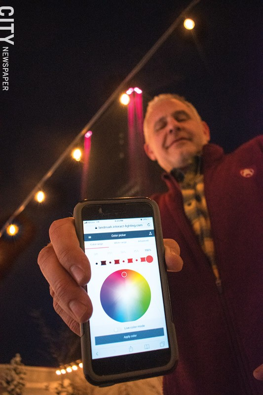 Mark Glickman, head of facilities at Buckingham Properties, shows the app he uses to control the lights on some of Buckingham's Properties. - PHOTO BY RYAN WILLIAMSON