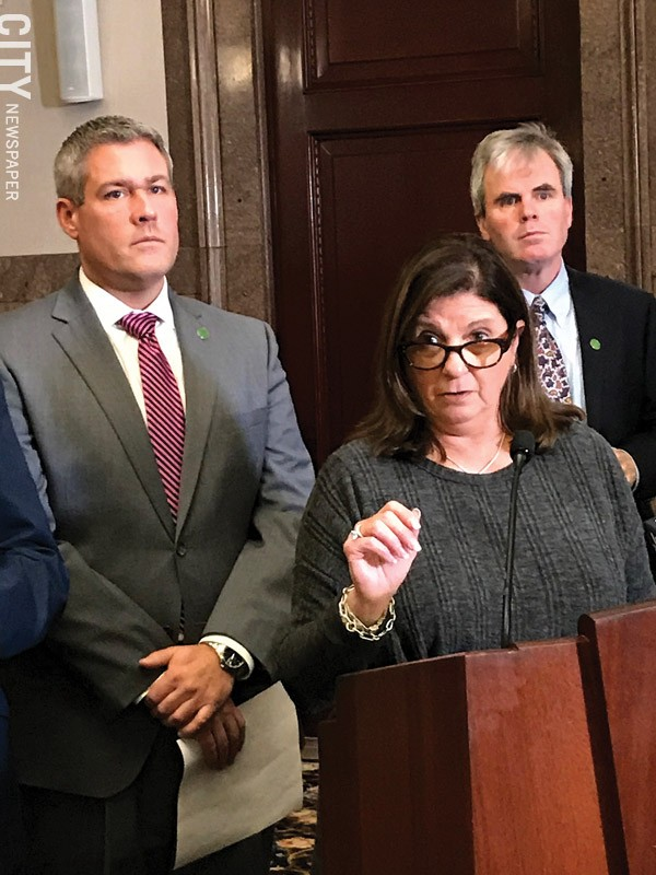 "Republican Monroe County Legislator Karla Boyce explains her decision to vote to repeal the ""police annoyance"" law she sponsored months ago, as  Monroe County Executive Adam Bello, left, and Democratic Legislator John Baynes look on."