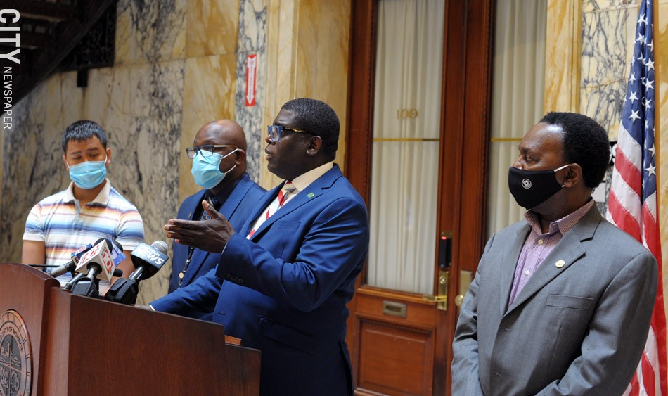 Vince Felder, Democratic minority leader of the County Legislature, defends elections commissioners LaShana Boose and Lisa Nicolay during a news conference Friday. standing with him are, from left, county legislators Calvin Lee, Ernest Flagler-Mitchell, and Frank Keophetlasy. - PHOTO BY JEREMY MOULE