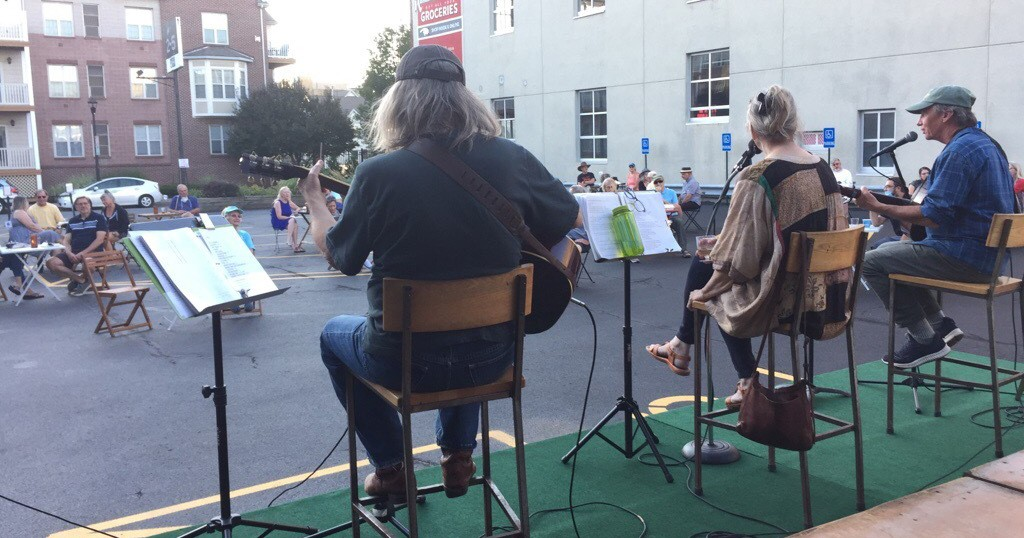 The Spring Chickens, performing outside The Little Theatre, from left to right: Steve Piper, Connie Deming and Scott Regan. - PHOTO BY JEFF SPEVAK